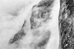Walls and Clouds... (Ody on the mount) Tags: anlässe berge dolomiten em5ii felsen felswand fototour gipfel mzuiko40150 nebel omd olympus sellamassiv urlaub wolken bw clouds mist monochrome mountains rocks sw vertical vertikal