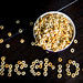 Top-down of a bowl of cereal and the word CHEERIOS