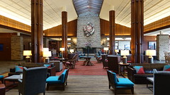 The Great Hall in Jasper Park Lodge in Jasper, Alberta, Canada (lhboudreau) Tags: lodge resort jasper jasperpark jaspernationalpark alberta canada park nationalpark jasperparklodge fairmontjasperparklodge fairmont building architecture interiordesign design interior inside room hall chair chairs sculpture wallsculpture fireplace art wallart column columns lighting lamps carpet carpeted symmetry cushion cushions ceiling greathall thegreathall lounge loungearea chimney table tables lamp ornate