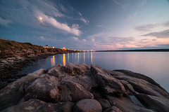 moonrise, cheticamp, nova scotia (Port View) Tags: fujixe3 cheticamp novascotia ns canada cans2s 2018 summer night moonrise water calm lights reflection rock moon clouds sunset color colour laowa9mm