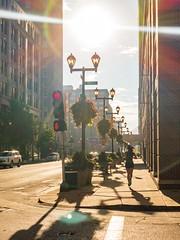 Morning Runner - Downtown Saint Louis (joncutrer) Tags: lensflare jcutrer royaltyfree creativecommons sidewalk buildings downtown flare curves stlouis stl missouri saintlouis street streets jog brilliant sun morning running fitness woman girl jogging