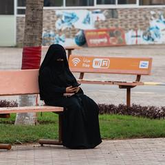 Free Wi-Fi (Packing-Light) Tags: middleeast oman omani salalah abaya burqa niqab hijab fashion culture women expression freedom monochrome voice religion conservative islam
