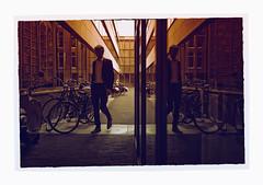 Red Man Walking (VanveenJF) Tags: art sony 35mm sel35f28 haarlem harlem nederland netherlands zeiss camera a7ll street red man walking bikes fiets office city town