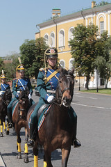 Russian Cavalry (peterkelly) Tags: digital canon 6d gadventures transmongolianadventure asia russianfederation russia moscow europe cavalry horses horse soldiers riding yellow blue army military building road hat