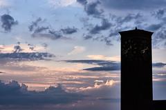 Clock hands in the dark (iamunclefester) Tags: münchen munich sunset steeple clock hand clockhand clouds vanilla sky cloud formation blue gray orange silhouette dark
