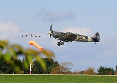 Spitfire take off (gillybooze) Tags: ©allrightsreserved aircraft spitfire airplane sky tree windsock trees grass wings vehicle plane clouds outdoor field warbird