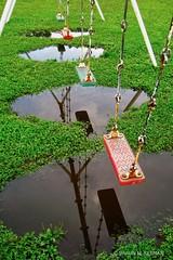 Rain Delay (Sapporo Shaun) Tags: rain swings green puddles japan asia playground hokkaido play