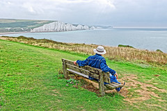 Selfie (Geoff Henson) Tags: selfie hat bench timer view vista sevensisters cliffs sea water ocean grass cloud sky