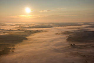 Paragliding, flying at sunrise.