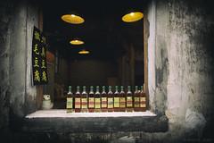 pick yours (Joshi Anand) Tags: anand joshi anandjoshi india pune shanghai rural china casual roadside wineshop liquershop wine liquer countrybar country handheld dof bokeh dim dimlit oldvillage