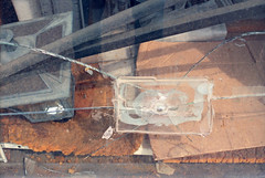 untitled (kaumpphoto) Tags: mamiya nc1000s kodak portra 800 window city urban street abstract minneapolis hole fix tape lantern light streak line broken damage abandon decay grime filth dirty rectangle patch texture stain cardboard crease shadow crack
