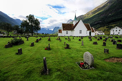 Cementery (Daniel Nebreda Lucea) Tags: church iglesia architecture arquitectura cementery cementerio tombs tumbas muerte desd life vida nature naturaleza landscape paisaje green verde travel viajar norway noruega flowers flores edificio religion god dios canon 1018mm 60d perspective perspectiva composition composicion mountains montañas wood wooden madera