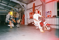 sideways. (jbondphotography) Tags: motorbikes scooter lightleak drunk film fujifilm superia 400 canon toptwin shed australia boys people bikes race 35mm 35 caught honda slippery sideways analog party loose laugh colour xtra