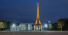 A Parisian Journey # 18 (Eiffel Tower II) (Aubrey Stoll) Tags: paris eiffel tower night glow light stars france blue hour tourist attraction cloud champ de mars military