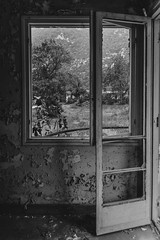 Looking Out From My Lonely Room... (panos_adgr) Tags: nikon d7200 monochrome bw abandoned hotel radion kamena vourla greece travel photography building architecture doors windows ambient light textures wall view