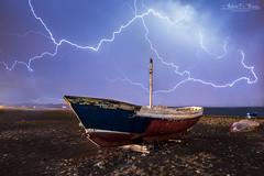 The storm falls on the boats // La tormenta cae sobre las barcas (Antonio F. Alvarez) Tags: storm boats beach night tormenta barcas playa noche nocturna thunderbolt thunder trueno relampago tamron nikond750 landscape paisaje seascape electric ray almería españa spain lightning