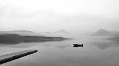 Calm (BDurk) Tags: calm water reflection lake boat dock smoke mountains black white gray national park glacier