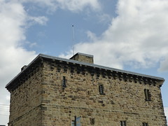 P1090813 - 2018-08-25 - Town - Hexham - Gaol (GeordieMac Pics) Tags: ©2018georgemcvitieallrightsreserved northumberland hexham dmc panasonic lumix fz200 geordiemac sky clouds gaol jail stonework