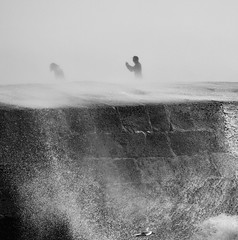 Photographing the waves (Hammerhead27) Tags: england olympus grey bw blackandwhite monochrome mono wind sea photography photo people storm wave wall cobb dorset lymeregis