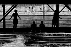 playground (heinzkren) Tags: wien vienna schwarzweis blackandwhite bw sw monochrome panasonic lumix candid people water donaukanal street streetphotography wall mauer graffiti silhouette boy pool river sport leisure freizeit action railing geländer city bath fun waves wellen urban badeschiff floatingpool float swim innamoramento