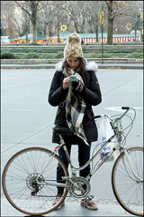 Columbus Circle Text - NYC (TravelsWithDan) Tags: youngwoman bicycle texting columbuscircle newyork manhattan nyc urban city street candid centralpark winter coatandhat canong3x