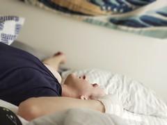 Lazy Saturday with a beautiful human (iamlewolf) Tags: person man fiance love iloveyou saturday lazy bed sunlight light bedroom hokusai thegreatwaveoffkanagawa tapestry beautiful