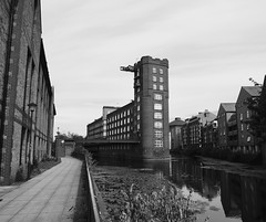 Rowntree Wharf, York (Hammerhead27) Tags: steps path sky weed water riverouse ouse heritage olympus scene view bw blackandwhite grey monochrome mono england retro building yorkshire york city river apartment historic industrial old wharf