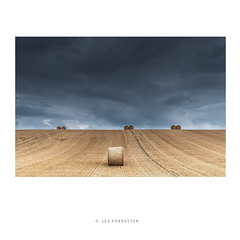 After the Harvest (les forrester) Tags: landscape skies stormy harvest bales hill mood drama fujifilm fujifimuk