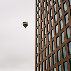 Floating Around (jameslf) Tags: berkshire buildings city cloudy morning people reading street town