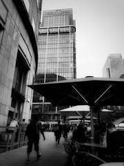 Beer in London Town (Greta Powell) Tags: london canarywharf finance banks building buildings black white dark people street mobilephone badphotography dof hangingaround city cities