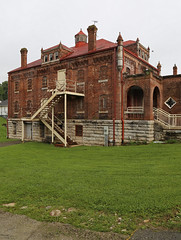 Scott County Jail — Georgetown, Kentucky (Pythaglio) Tags: georgetown kentucky scottcounty house dwelling residence building structure jail historic nrhp nationalregister 02000923 1892 romanesque turrets bars staircase corbelling
