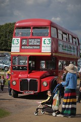 The Bus Trip (Henry Hemming) Tags: bus doubledecker double decker routemaster red people sightseers daytrippers daytrip treasurehouse castle medieval england summer sun baby pushchair woman nationaltrust knole park uk united kingdom kent