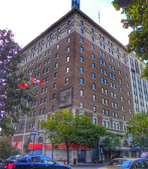 Hamilton Ontario - Canada -  Royal Connaught Hotel  - Abandoned Photo - Now converted to a Condominium. (Onasill ~ Bill Badzo) Tags: st street main 624 onasill corktown original condominium condo reuse adaptive converted old vintage photo abandoned historic heritage hotel connaught royal canada ont ontario on hamilton abandon entrance canopy road tree car neon sign scaffold howard johnston