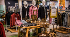 2018 - Germany - Heidelberg - Galeria Kaufhof Lederhosen (Ted's photos - For Me & You) Tags: 2018 cropped germany heidelberg nikon nikond750 nikonfx tedmcgrath tedsphotos vignetting lederhosen galeriakaufhof kaufhofheidelberg heidelberggermany vest vests clothing shirts racks store shop shopping display storedisplay manequin jacket