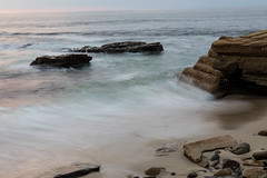 Rocks and Waves at High Tide with light from the setting sun (Photos By Clark) Tags: california lajolla beachshots subjects northamerica location canon2470 canon5div unitedstates sandiego cities locale places where us lightroom thesandiegoist waves rocks pacific tide water ocean blue green sunset tripod