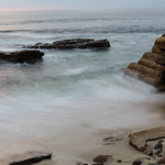 Rocks and Waves at High Tide with light from the setting sun thumbnail