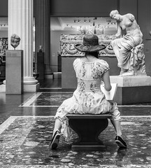 The Seated Muse (John St John Photography) Tags: metmuseum metropolitanmuseumofart streetphotography candidphotography greekandromangalleries youngwoman hat sketching drawing art sculpture theseatedmuse bw blackandwhite blackwhite blackwhitephotos johnstjohnphotography