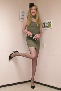 Short green dress.