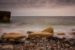 Portland Stone and Sea (Howard 'H' Pimborough) Tags: howardhpimborough canon7d 1740mmf4l filter longexposure bwnd10 portland dorsett stones sea seaweed clouds cliffs water waves