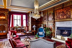The Red Drawing Room (rustyruth1959) Tags: home house potplants plants sofa bluechair woodcarving skeleton drawingroom reddrawingroom burtonagnes burtonagneshall tamron16300mm nikond5600 chandelier room carving painting photograph window wood chairs furniture carpet indoor nikon hall elizabethan yorkshire uk england fire hearth floor ceiling run runner ornament lights glass table curtains antique lamp