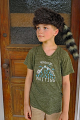 In a Raccoon Hat (FAIRFIELDFAMILY) Tags: ridgeland sc south carolina hat cap coon skin raccoon shutter window snake hinge house ufo bowman welcome center zip line park treehouse jason taylor tree porch door victorian child carson grant tourist attraction roadside winnsboro fairfield county southern living garden gun fun explore exploring outside young old pretty architecture design boy boys