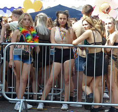 Barrier (Andy WXx2009) Tags: people outdoors barrier fence festival crowd group party brunette gaypride mardigras girls femme teenagers women candid cardiff wales europe beauty blonde sexy shorts legs fashion style streetphotography friends