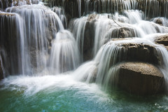 Kuang Si Waterfalls... (Syahrel Azha Hashim) Tags: 2018 laos sonyimages nature sony shallow holiday nopeople freshwater trees details waterfalls waterstream highcontrast motionblur slowshutter kuangsiwaterfalls touristattraction clouds asia 35mm syahrel getaway handheld sonya7 colorimage vacation luangprabang prime light dof naturallight longexposure colorful dramaticsky beautiful travel motion relaxing greenwater colors destination stream a7ii simple detail