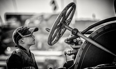 Never too young to learn to drive.. (Andy J Newman) Tags: 50thanniversary boy monochrome street big blackandwhite blandford candid d500 dorset gdsf humor humour lad ladies nikon portrait silverefex steam steamfair traction wheel young