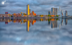 In a distant reflection (Robert Stienstra Photography) Tags: rotterdam reflection reflections phatasy blue hour bluehour cityscape cityscapes waterscape waterscapes waterfront architecture skyline skylines 010 zuidholland sunset sunsets nikond7100 buildings riverbanks riverscape outdoor gers