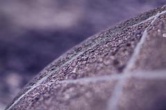 The cross. Promises glittering luxury. (Gudzwi) Tags: rock macromondays mm hmm makro macro closeup blur unschärfe glitzer glitter bokeh schatten shadow licht light natur nature geschliffen gestein sediment kiesel kieselstein pebble stein stone calcite kalzit kalkspat macromondaysseptember10rock kreuz cross micronikkorp12855mm