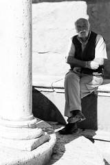 Sitting in the Shade of Pius II (Xerones) Tags: tuscany pienza portrait bw leicaq tuscany2018