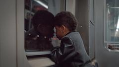Kid on the train. (Jovan Jimenez) Tags: canon eos 7ne ef stm kodak portra 800 film kid boy people cinematic grain train 7s 33v 30v street analog analogue elan cta 40mm pancake