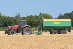 Case IH Magnum 335 Tractor with a Hawe Chaser Bin (Shane Casey CK25) Tags: case ih magnum 335 tractor hawe chaser bin cnh red casenewholland newholland traktor traktori tracteur trekker trator ciągnik grain harvest grain2018 grain18 harvest2018 harvest18 corn2018 corn crop tillage crops cereal cereals golden straw dust chaff county cork ireland irish farm farmer farming agri agriculture contractor field ground soil earth work working horse power horsepower hp pull pulling cut cutting knife blade blades machine machinery collect collecting nikon d7200