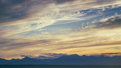 // it's what i do (pnwbot) Tags: seattle sunset clouds smoke whisps mountains landscape blue yellow orange grey calm serene hazy chill